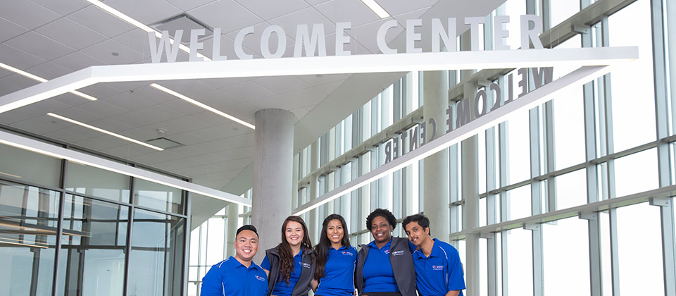 UHD student ambassadors at the 3rd floor Welcome Center facing Travis Street